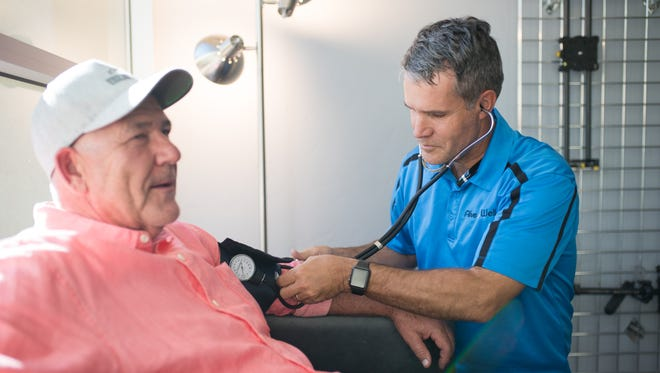 Bill Edwards, Co-Founder of Squatty Potty, has his blood pressure checked during a routine exam by J.R. Martin