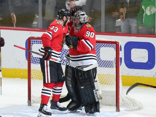competitive price 08b09 2b4f8 Emergency goalie Scott Foster shuts door for Blackhawks ...