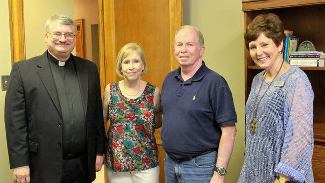 Fr. Joseph Martina of Our Lady of Fatima, Joann Worley of Catholic Charities, Monroe, Joseph Worley and Laurie Major from Louisiana Hospice and Palliative Care visit at the grand opening of the Catholic Charities office in Monroe on May 24.