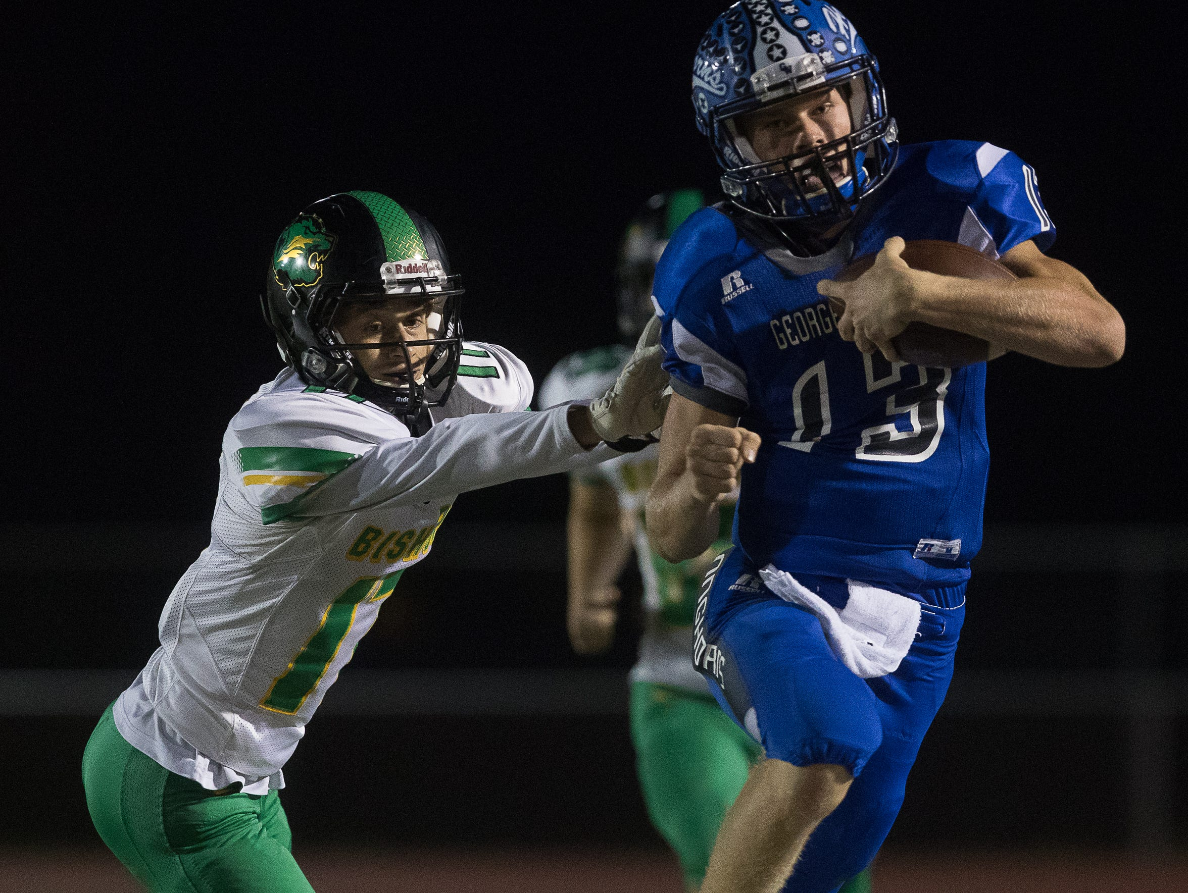 George-West's quarterback Dakota Wallek is pushed out