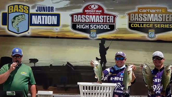 From left, Kansas BASS Nation youth director Travis Burch announces over the loudspeaker as Kansas State's Michael Mueting and Zach Vielhauer weigh in their fish June 27 on Day 1 on the KBN College State Championship at Wilson Reservoir. Vielhauer and Mueting won the event by more than two pounds.