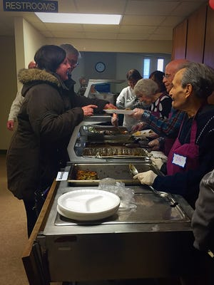 More than 75 volunteers make the annual free Thanksgiving meal at the River Community Church possible.