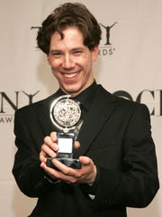 """John Gallagher Jr. poses with the award for """"Best Performer by a Featured Actor in a Musical""""  in the press room at the 61st Annual Tony Awards at Radio City Music Hall on June 10, 2007."""