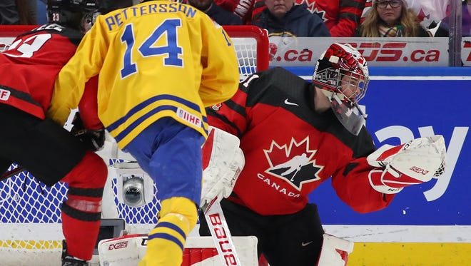 Carter Hart won gold for Canada at the World Junior Championship and was the first three-time winner of the Del Wilson Trophy as the best goalie in the WHL.
