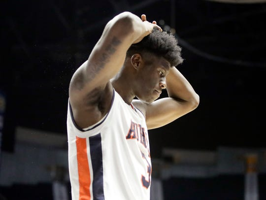 Auburn forward Danjel Purifoy leaves the court after