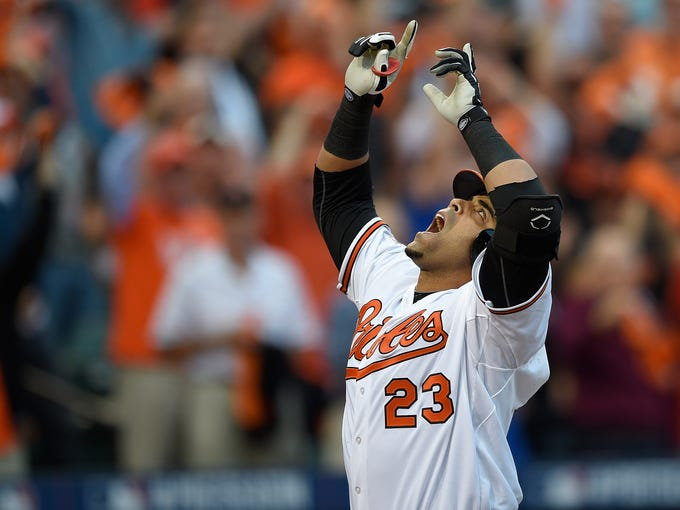 Baltimore Orioles designated hitter Nelson Cruz gestures after his two-run  home run in the 8d1566487