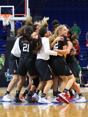Stanford celebrates after defeating Notre Dame in the final of the Lexington Regional of the women's 2017 NCAA Tournament.
