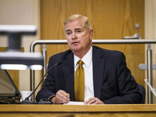 Albuquerque Chief of Police Gorden Eden sits in the witness stand as the first witness in the trial of former Albuquerque police officers Dominique Perez and Keith Sandy who are charged with the 2014 murder of James Boyd in Bernalillo County court Monday, Sept. 19, 2016 in Albuquerque, NM.
