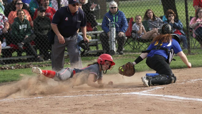 Bellevue's Sophia Pressler scores a run in the Division II district tournament against Ontario at Milan on Wednesday.