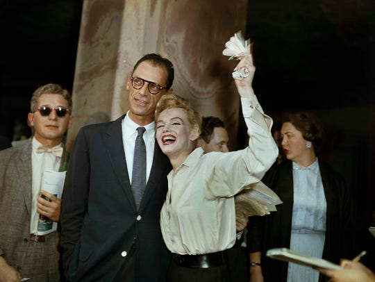 Newlyweds Marilyn Monroe (right) and Arthur Miller
