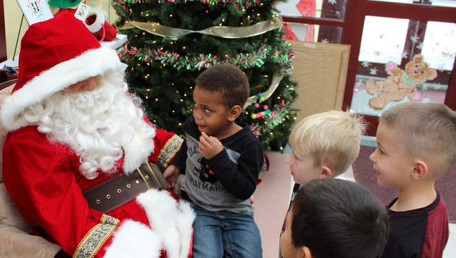 Youngsters at the downtown Day Nursery of Abilene location got a surprise visit Friday afternoon from Santa, who arrived not in a sleigh but a black SUV. Santa also made director Cynthia Pearson's day when he presented her present, a check from Community Foundation of Abilene.