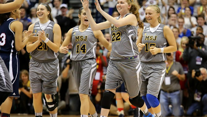 Lauren Hill is congratulated by her teammates during her collegiate debut on Nov. 2.
