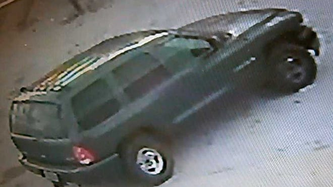 The video shows a green Dodge Durango towing the stolen utility trailer from the property.