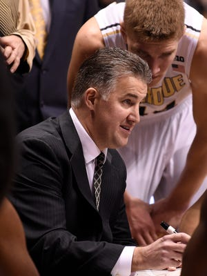 Purdue coach Matt Painter talks to his team in the second half of a 72-68 victory over Minnesota.