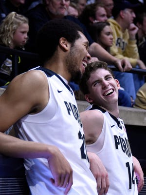 Purdue center A.J. Hammons (20) and guard Ryan Cline (14) laugh during in the second half of a season-opening win over North Carolina A&T on Nov. 13.