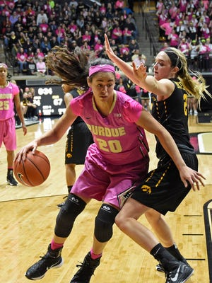 Purdue Boilermakers forward Dominique McBryde (20) drives around Iowa Hawkeyes guard Ally Disterhoft (2) in the 2nd half at Mackey Arena Jan 24, 2016. Purdue won the game 90-73.