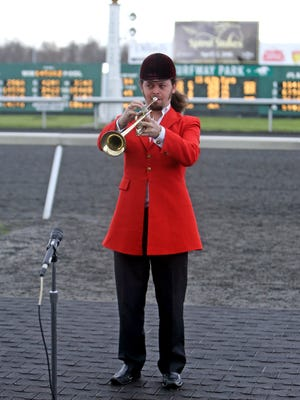 """Turfway Park's Sean Fitzpatric plays """"The Call To The Post"""" at the 2016 Spiral Stakes Race at Turfway Park in Florence, Kentucky."""