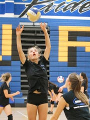 Junior setter Amani Dunston has developed into a team