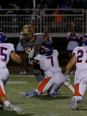 Westlake High's Cameron Trimble, (7) brings down Oak Christian's Colby Parkinson during a game last season. On Wednesday, Trimble will make it official and sign to play college football at UC Davis. Parkinson is headed to Stanford.