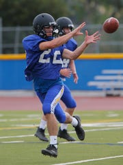 Agoura High's Nico Della Ripa makes a reception during