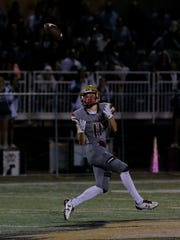 Oaks Christian's Bryce Farrell makes a deep catch during a Division 2 semifinal game against Upland last season. The Lions won the Division 2 title and were moved up to Division 1 this season.