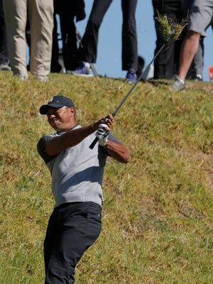 Tiger Woods blasts out of the rough on the fifth hole during the first round of the Genesis Open at Riveria Country Club in Pacific Palisades on Thursday. Woods shot a 1-over-par 72.
