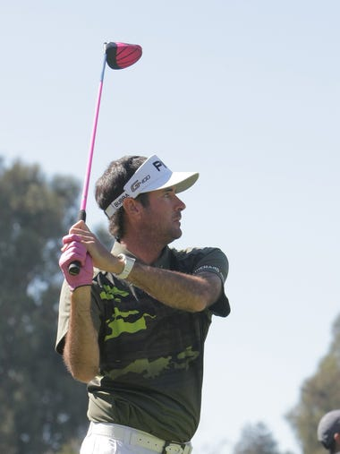 Bubba Watson watches his tee shot on the ninth hole