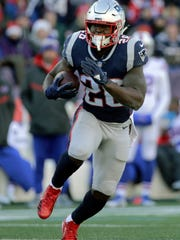 FILE- In this Dec. 23, 2018, file photo, New England Patriots running back Sony Michel carries the ball against the Buffalo Bills during the first half of an NFL football game in Foxborough, Mass. Sony Michel was a freshman and Todd Gurley a junior when the pair shared the backfield together at the University of Georgia. Now the former Bulldogs teammates will be on opposite sides when they meet in the Super Bowl. (AP Photo/Elise Amendola, File)
