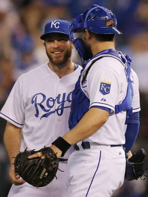 Greg Holland, left, is a free agent after being cut by the Kansas City Royals.