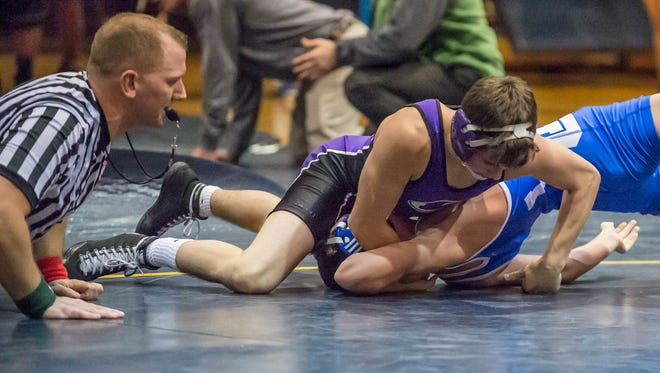 Lakeview's Brendan Stevens pins Harper Creek's Hunter Mainstone during a quad meet on Dec. 9.