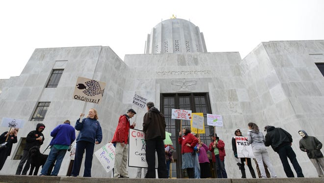 Protestors rally against GMOs during a special session at the Oregon State Capitol in Salem on Monday, Sept. 30, 2013.