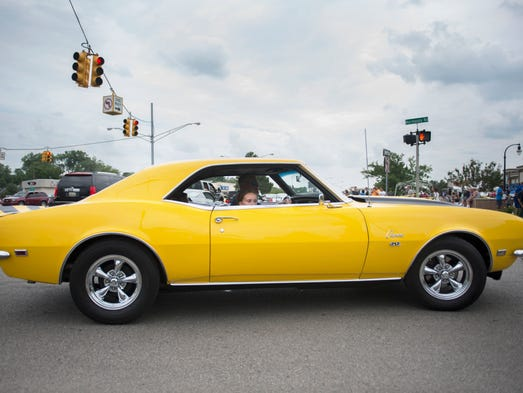 A Camaro SS drives down Woodward for the Dream Cruise