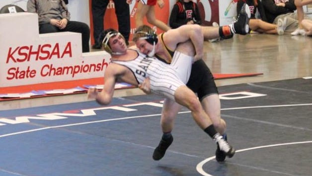 Two-time Kansas state champion Nick Nolting (black singlet) picked Iowa State over Missouri and Oklahoma State.