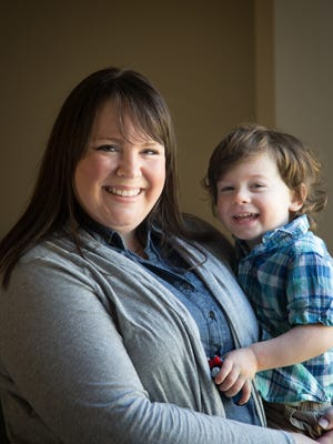 Kelli Schoney holds her son Clark, 2, at their home in Urbandale on Friday, April 15, 2016.