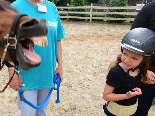 Harlow reacts as her horse, Luna, makes a funny face