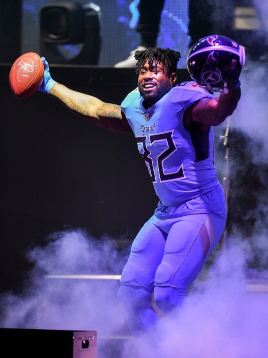 Tennessee Titans tight end Delanie Walker takes the stage as the NFL football team revealed its redesigned uniforms, in Nashville, Tenn., Wednesday, April 4, 2018. (Andrew Nelles/The Tennessean via AP)