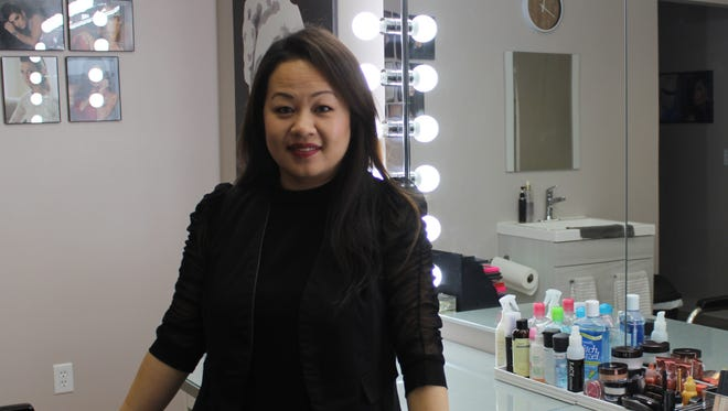 Vanexa Yang stands in her recently completed makeup and facial studio.