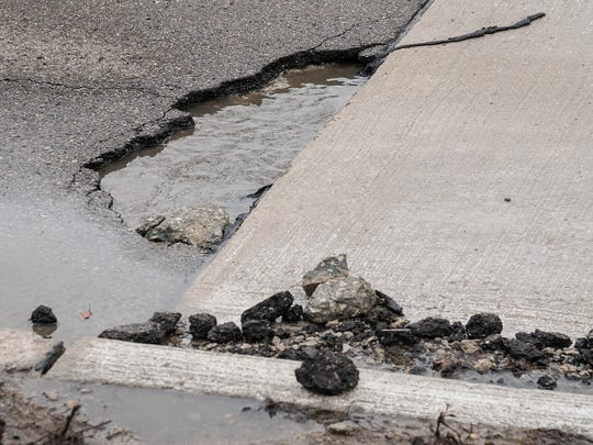 Water in the pothole can fool you. It's deeper than it looks.