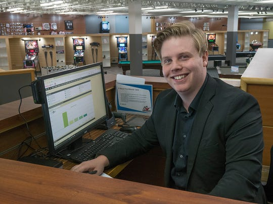 Adam Holt, a Livonia resident, works at new Game Room Guys store.