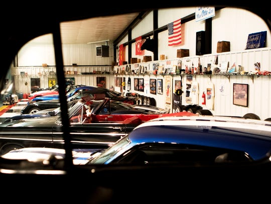 Cars including a 1969 Mustang, a 1964 Ford Falon, a