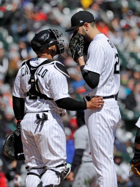 Chicago White Sox starting pitcher Lucas Giolito, right, talks with catcher Welington Castillo during the third inning of a baseball game against the Detroit Tigers, Saturday, April 7, 2018, in Chicago. (AP Photo/Nam Y. Huh)