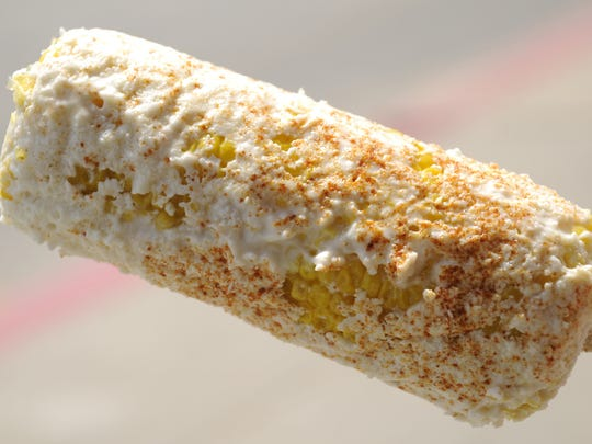 The corn on the cob, with mayo, cheese and ground chili powder at La Tapatia Tienda Mexican Monday, Aug. 1, 2011. Eric Rowley/Juice