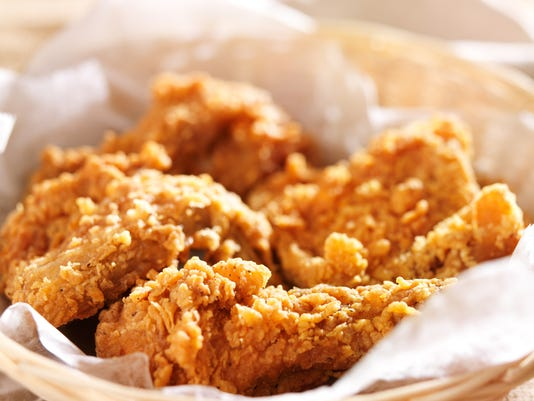 fried chicken in a basket in natural light