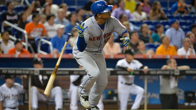 Mets center fielder Juan Lagares connects for a three run RBI double in the seventh inning.