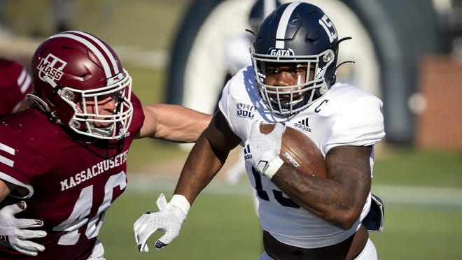 Georgia Southern running back J.D. King (15) runs away from Massachusetts linebacker Cole McCubrey (46) for a gain during a game Oct. 17 in Statesboro.