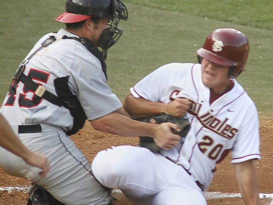 Georgia catcher Jason Jacobs (45) tags out Travis Anderson