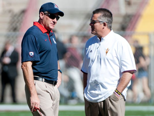 Rich Rodriguez and Todd Graham