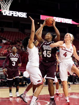Mississippi State center Chinwe Okorie (45), center, tries to shoot while defended by Arkansas center Alecia Cooley (35), left, and Arkansas guard/forward Keiryn Swenson (4) during the first half.