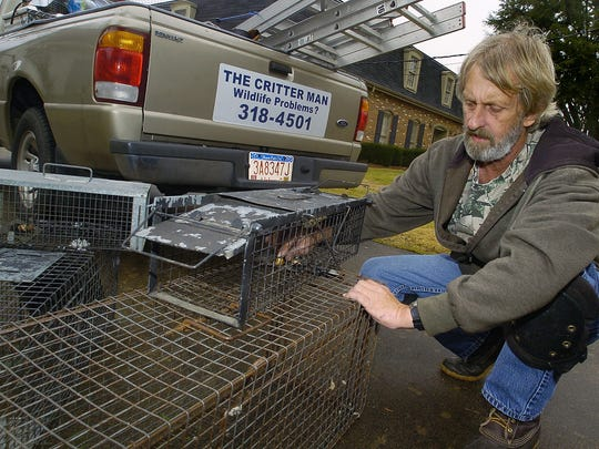 December 27, 2007 - Skip McNeill baits a small animal trap at a home in Montgomery, Ala. on Thursday December 27, 2007. McNeill, known as Skip the Critter Man, runs a nuisance animal control company in the Montgomery area. (Montgomery Advertiser, Mickey Welsh)