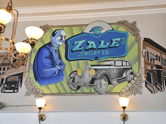 A mural based on archived photos was painted by artist David Fowler at the new Karat Bar and Bistro located downtown in the historic Zales Building. The business opened Friday along with the Ganache-to-Go bakery.